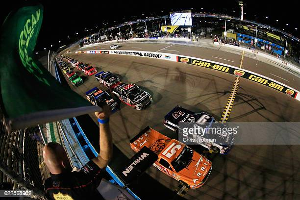 William Byron driver of the Liberty University Toyota and Daniel Suarez driver of the ARRIS Toyota lead the field past the green flag to start the...