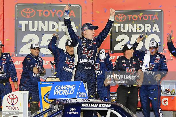 William Byron driver of the Liberty University Toyota celebrates in Victory Lane during the NASCAR Camping World Truck Series Toyota Tundra 250 at...