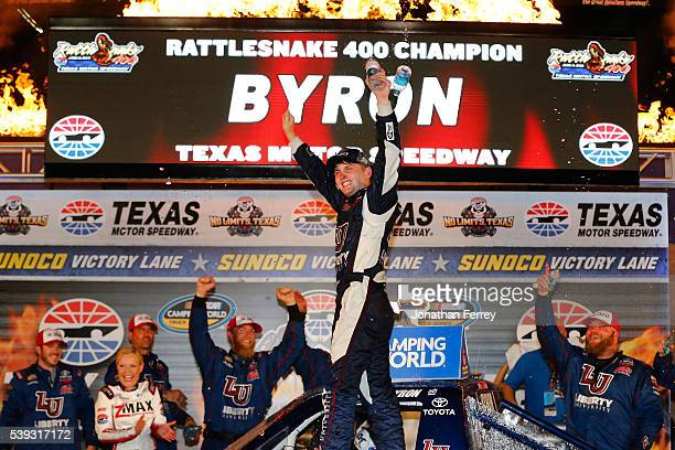 William Byron driver of the Liberty University Toyota celebrates in victory lane after winning the NASCAR Camping World Truck Series Rattlesnake 400...