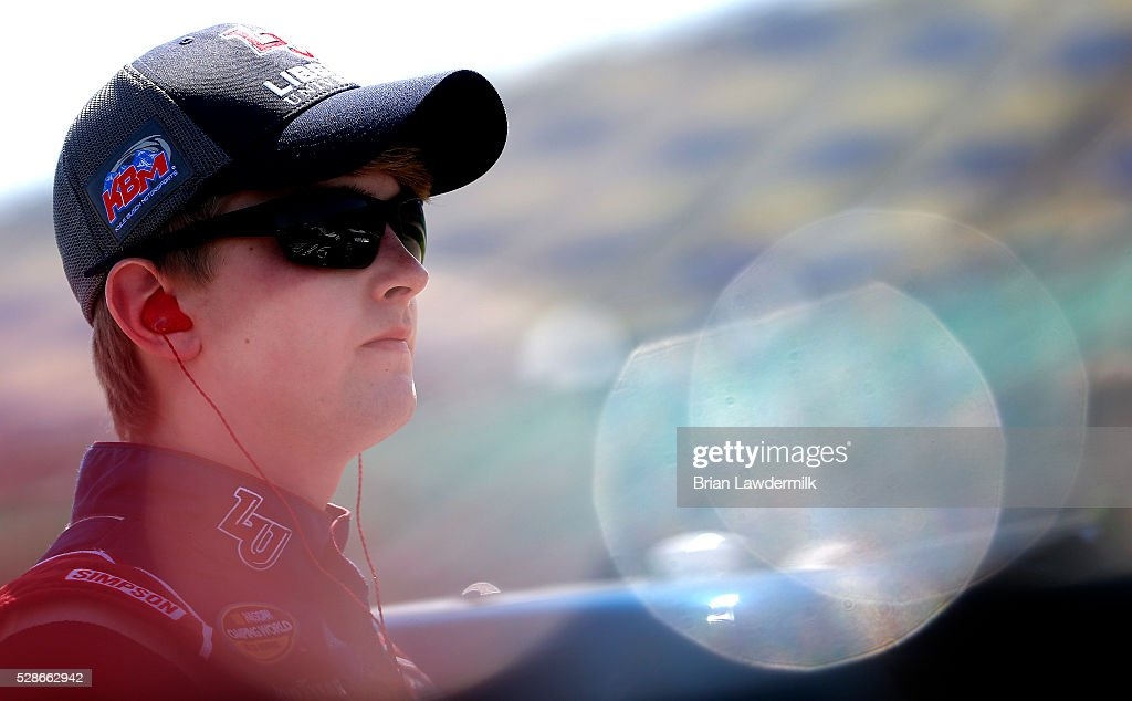 William Byron, driver of the #9 Liberty University Toyota, looks on during qualifying for the NASCAR Camping World Truck Series Toyota Tundra 250 at Kansas Speedway on May 6, 2016 in Kansas City, Kansas.