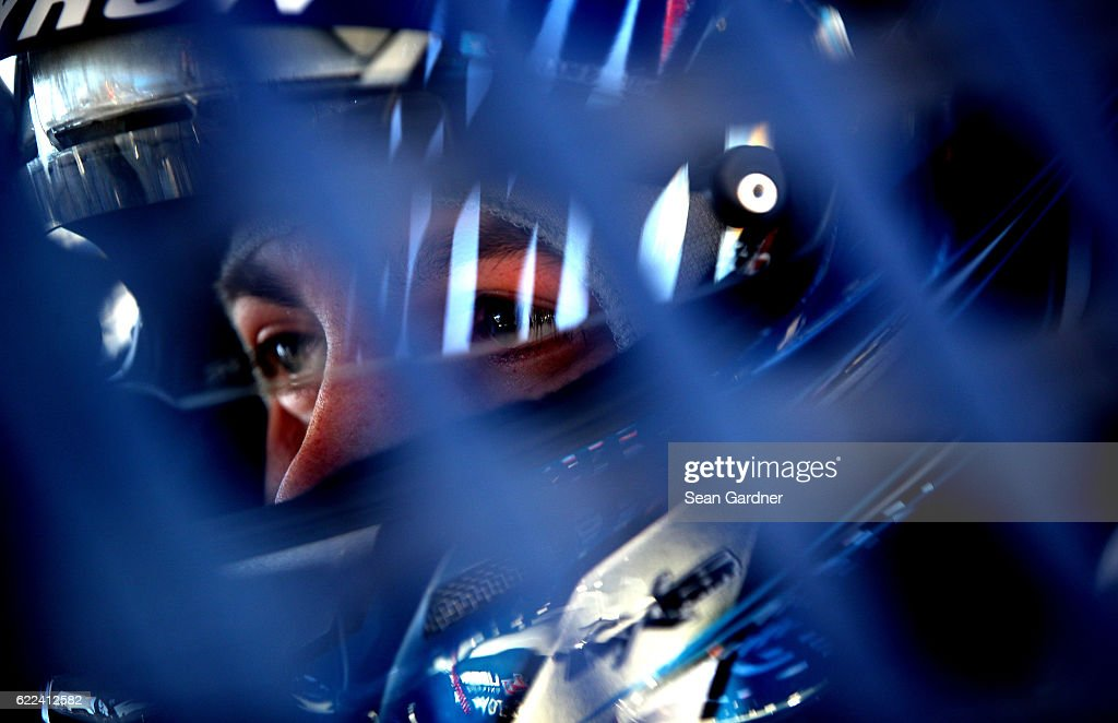 William Byron, driver of the #9 Liberty University Toyota, sits in his car during practice for the NASCAR Camping World Truck Series Lucas Oil 150 at Phoenix International Raceway on November 11, 2016 in Avondale, Arizona.