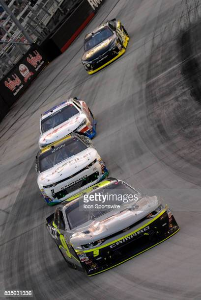 William Byron JR Motorsports Chevrolet Camaro leads a pack of cars through turn three during the Food City 300 on August 18 at the Bristol Motor...