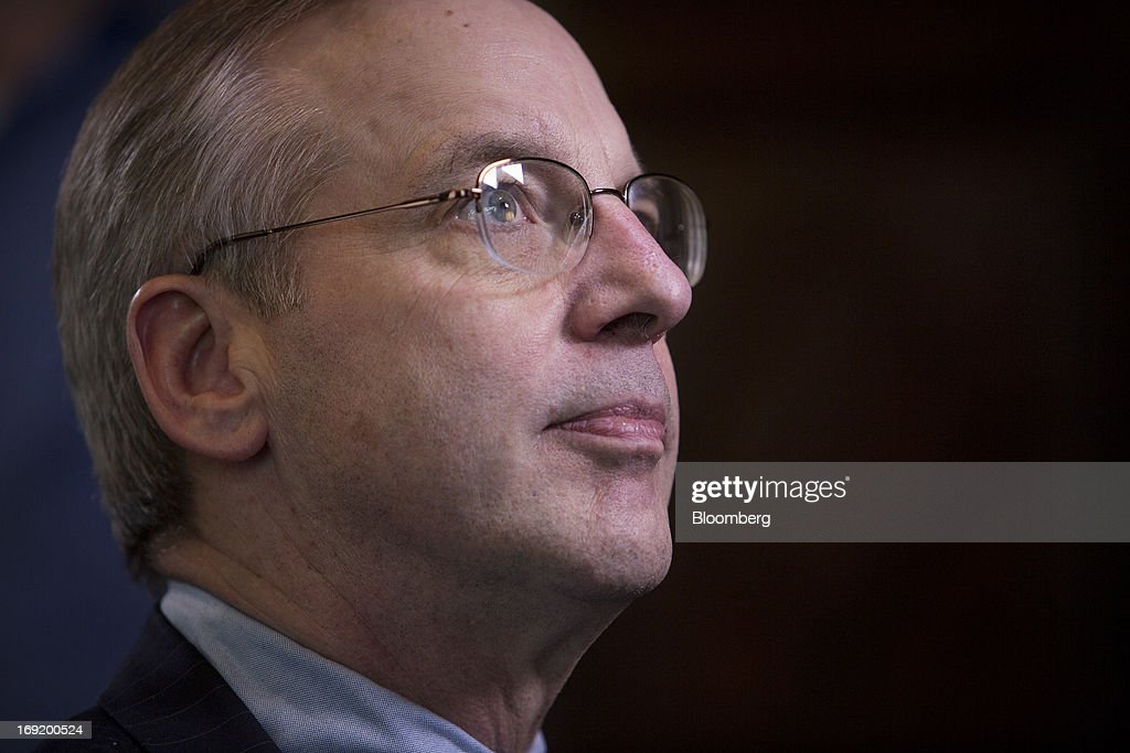 William C. Dudley, president and chief executive officer of the Federal Reserve Bank of New York, chats before an interview in New York, U.S., on Tuesday, May 21, 2013. Dudley said he has not decided whether the Fed's next move should be to enlarge or shrink its bond buying program as he called for a fresh look at its eventual retreat from record asset purchases. Photographer: Scott Eells/Bloomberg via Getty Images