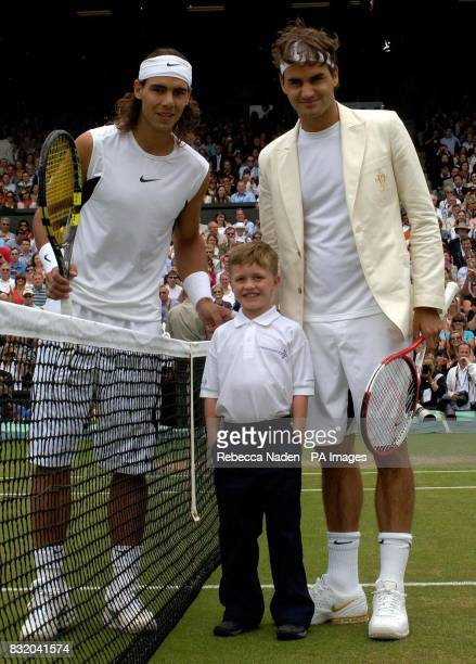 William Caines sevenyearsold from Beckenham Kent representing Cancer Research UK poses with Switzerland's Roger Federer and Spain's Rafael Nadal...
