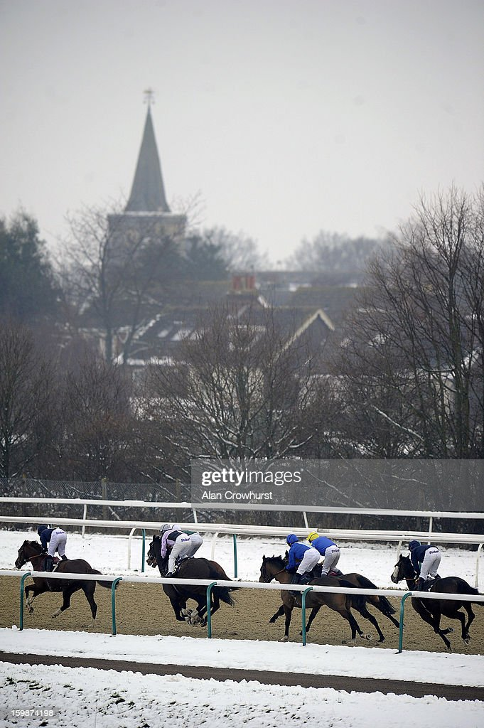 William Carson riding Harry Buckle (L) on their way to winning The Lingfield Park Marriott Hotel Handicap Stakes at Lingfield racecourse on January 22, 2013 in Lingfield, England.