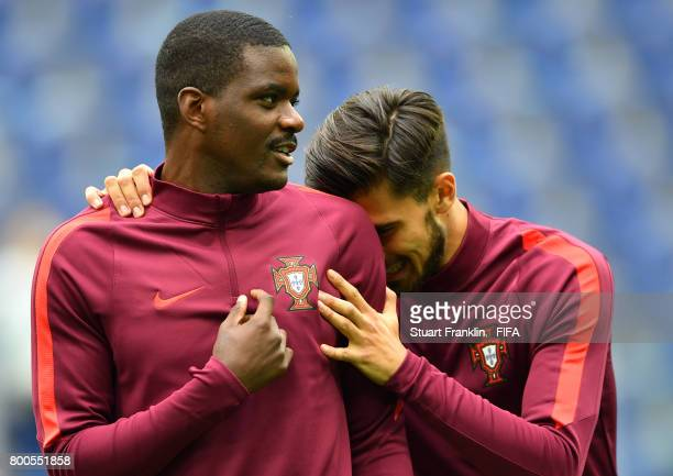 William Carvalho of Portugal and Andre Gomes of Portugal embrace prior to the FIFA Confederations Cup Russia 2017 Group A match between New Zealand...