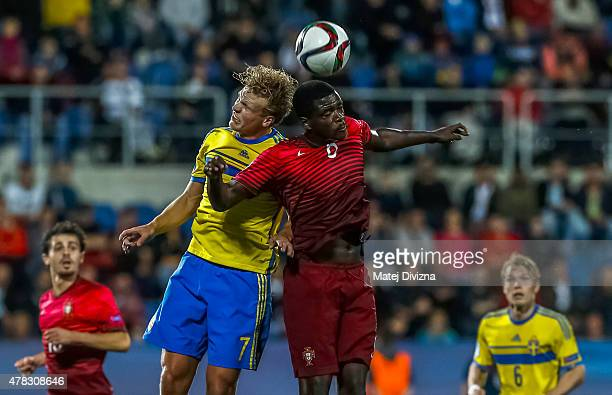 William Carvalho of Portugal battles for the ball with Oscar Hiljemark of Sweden during UEFA U21 European Championship Group B match between Portugal...