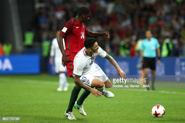 William Carvalho of Portugal challenges Pablo Hernandez of Chile during the FIFA Confederations Cup Russia 2017 SemiFinal match between Portugal and...