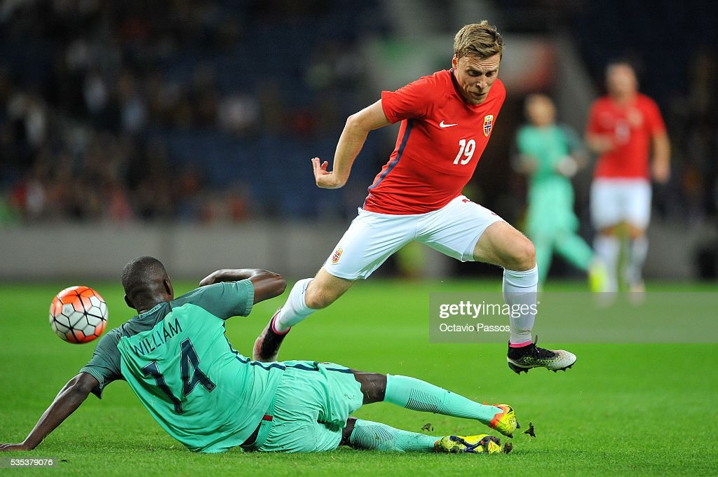 William Carvalho of Portugal challenges Ruben Jenssen of Norway during the International Friendly match between Portugal and Norway at Dragao Stadium on May 29, 2016 in Porto, Portugal.