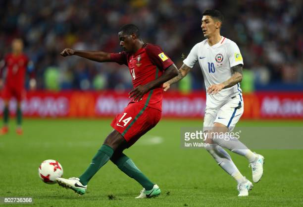 William Carvalho of Portugal clears the ball while under pressure from Pablo Hernandez of Chile during the FIFA Confederations Cup Russia 2017...