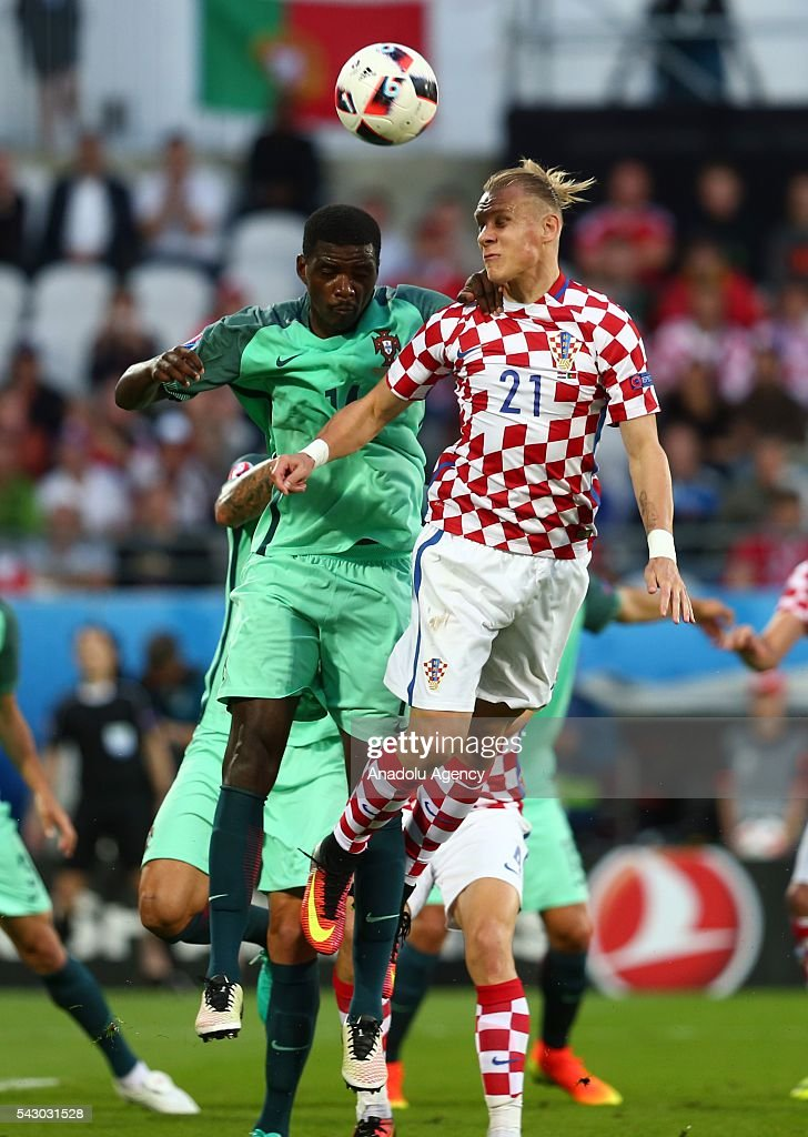 William Carvalho (L) of Portugal in action against Domagoj Vida (R) of Croatia during the Euro 2016 round of 16 football match between Croatia and Portugal at Stade Bollaert-Delelis in Lens, France on June 25, 2016.