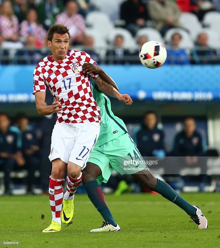 William Carvalho (R) of Portugal in action against Mario Mandzukic (L) of Croatia during the Euro 2016 round of 16 football match between Croatia and Portugal at Stade Bollaert-Delelis in Lens, France on June 25, 2016.
