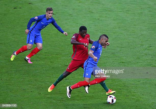 William Carvalho of Portugal tackled Dimitri Payet of France during the UEFA EURO 2016 Final match between Portugal and France at Stade de France on...