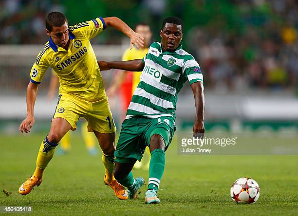 William Carvalho of Sporting Lisbon battles with Eden Hazard of Chelsea during the UEFA Champions League Group G match between Sporting Clube de...