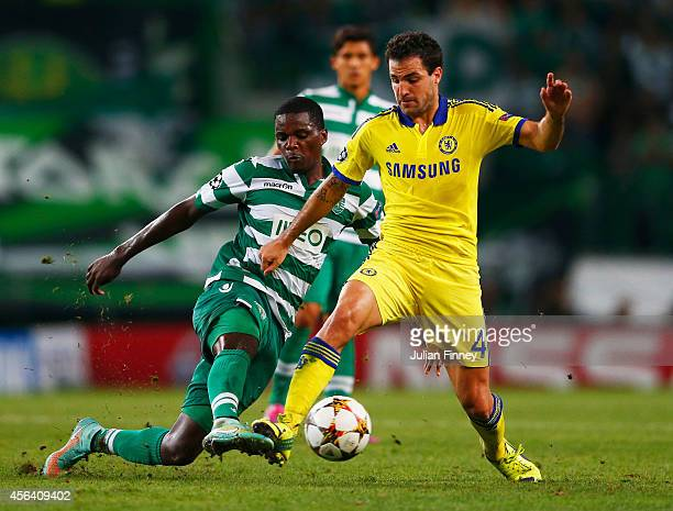 William Carvalho of Sporting Lisbon tackles Cesc Fabregas of Chelsea during the UEFA Champions League Group G match between Sporting Clube de...