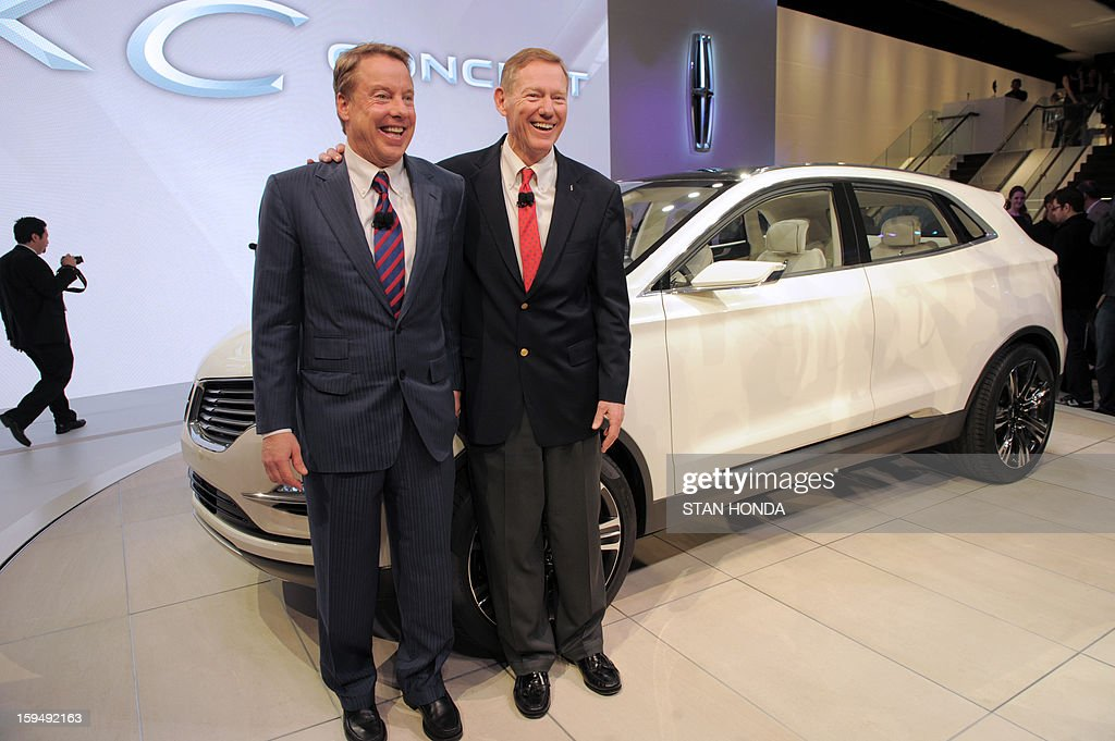 William Clay Ford Jr. (L), Executive Chairman of Ford, and Alan Mulally (R), President and Chief Executive Office for Ford, pose for a picture with the 2014 Lincoln MKC Concept cross-over SUV as it is introduced at the 2013 North American International Auto Show in Detroit, Michigan, January 14, 2013. AFP PHOTO/Stan HONDA