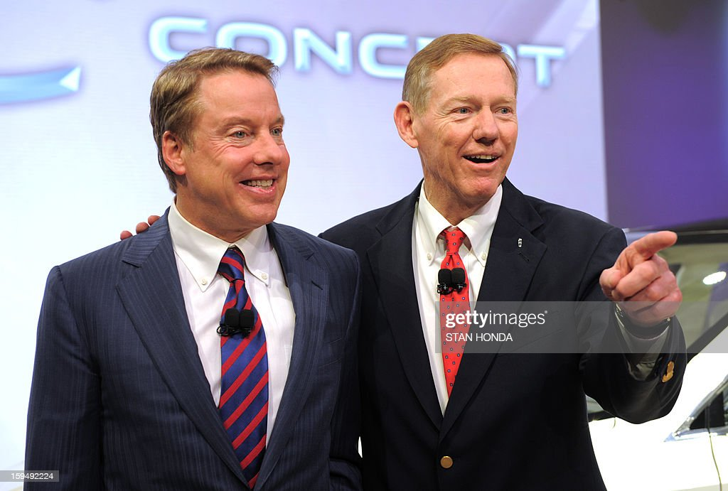 William Clay Ford Jr. (L), Executive Chairman of Ford, and Alan Mulally (R), President and Chief Executive Office for Ford, pose together after the 2014 Lincoln MKC Concept cross-over SUV is introduced at the 2013 North American International Auto Show in Detroit, Michigan, January 14, 2013. AFP PHOTO/Stan HONDA