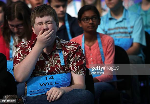 William Cooper of Redding California yawns as he waits for his turn to spell during the 2016 Scripps National Spelling Bee May 25 2016 in National...