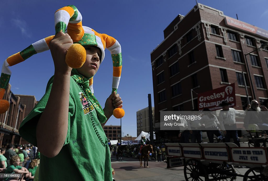 William Cothran, 9, sports an Irish jester hat while watching the 50th annual Denver St. Patrick's Day parade Saturday morning. Thousands of parade-goers lined streets in lower downtown to watch hundreds of entrants including floats, dancers, bands, equestrian and animal groups. Andy Cross, The Denver Post