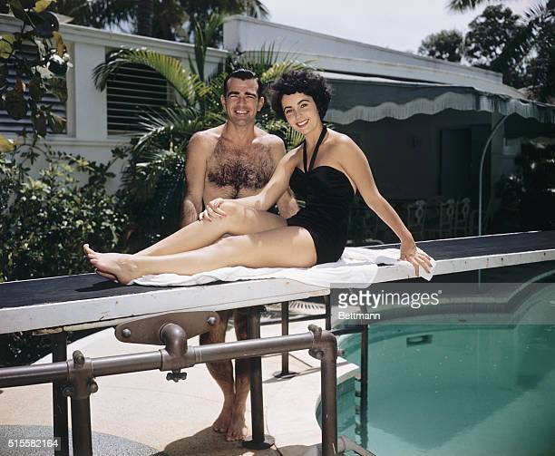 William D Pawley Jr and his fiancee 17yearold Elizabeth Taylor relaxing poolside in summer 1949 at the Miami Beach home of Pawley's father a former...