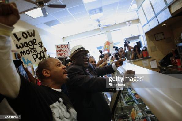 William D Smart Jr pastor of the Southern Christian Leadership Conference right protests with Fastfood workers and supporters organized by the...