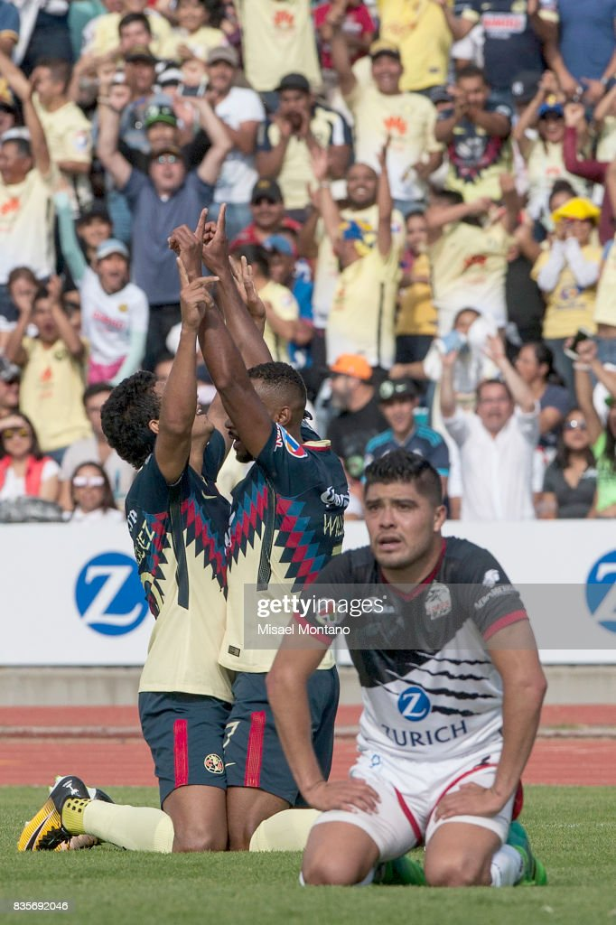 William da Silva of America celebrates with teammate Cecilio Dominguez after scoring the first goal of his team during the fifth round match between Lobos BUAP and America as part of the Torneo Apertura 2017 Liga MX at Olimpico de la BUAP Stadium on August 19, 2017 in Puebla, Mexico.