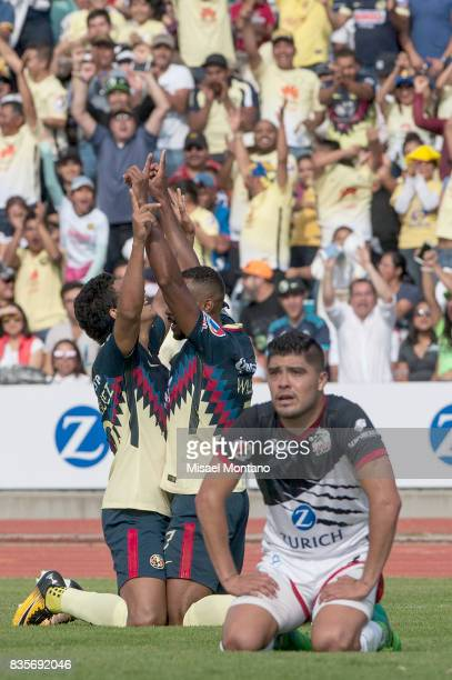 William da Silva of America celebrates with teammate Cecilio Dominguez after scoring the first goal of his team during the fifth round match between...
