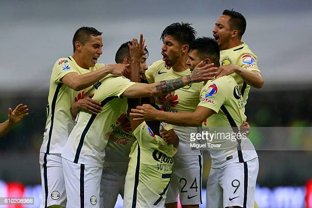 William Da Silva of America celebrates with teammates after scoring the second goal of his team during the 11th round match between America and Pumas...