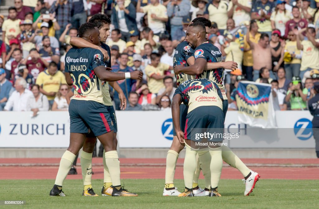 William da Silva of America celebrates with teammates after scoring the first goal of his team during the fifth round match between Lobos BUAP and America as part of the Torneo Apertura 2017 Liga MX at Olimpico de la BUAP Stadium on August 19, 2017 in Puebla, Mexico.