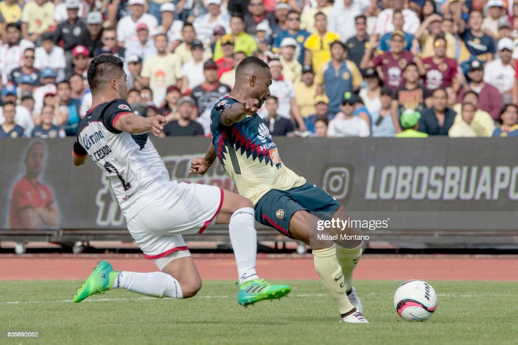 William Da Silva of America shoots to score the first goal of his team during the fifth round match between Lobos BUAP and America as part of the Torneo Apertura 2017 Liga MX at Olimpico de la BUAP Stadium on August 19, 2017 in Puebla, Mexico.