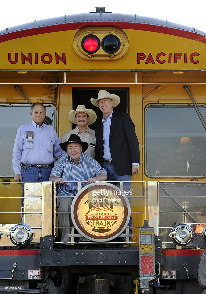 William Dean Singleton, Chairman and Publisher of the Denver Post and Chairman of MediaNews Group, Inc., front, poses for a portrait with (l-r) Mike Shaw, of Mike Shaw Automotive, Ed Moss, President & CEO of the Denver Post and Governor John Hickenlooper, while boarding The Denver Post Cheyenne Frontier Days train in Denver, CO, Saturday, July 21, 2012. Those traveling were headed for the Rodeo at Cheyenne Frontier Days. The steam locomotive No. 844 was the last built for the Union Pacific Railroad. The 454-ton steamer can reach speeds of 100 mph. Craig F. Walker, The Denver Post