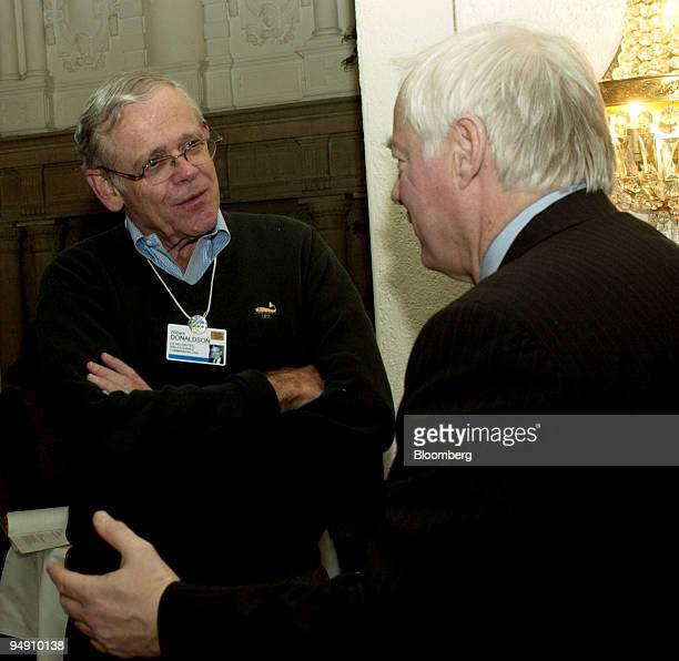 William Donaldson chairman Securities and Exchange Commission chats with another participant in the lobby of the Hotel Belvedere during the World...