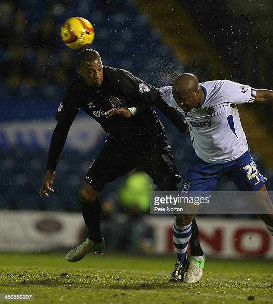 William Edjenguele of Bury challenges for the ball with Clive Platt of Northampton Town during the Sky Bet League Two match between Bury and...