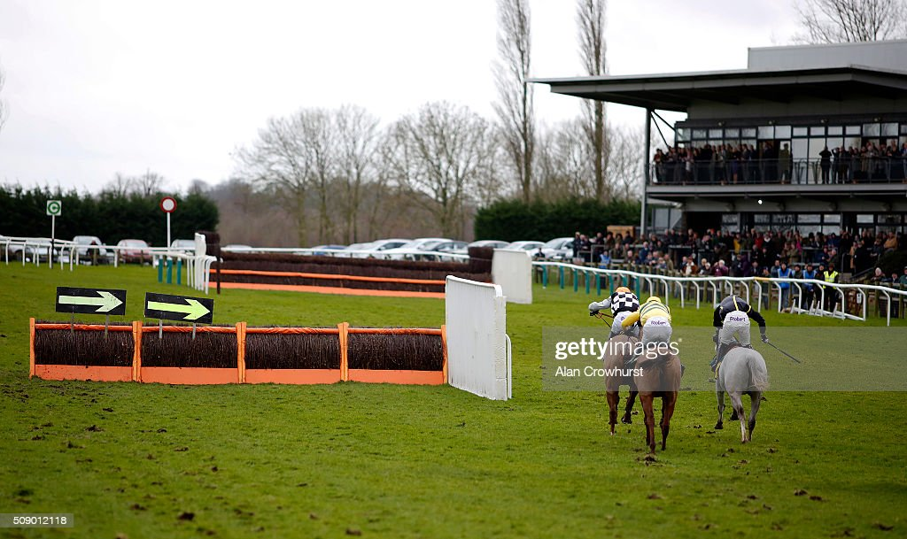 William Featherstone riding Vent Nivernais (L) by-pass the last hurdle to win The Fakenham Racecourse Supports Racing To School Maiden Handicap Hurdle Race at Fakenham racecourse on February 08, 2016 in Fakenham, England.