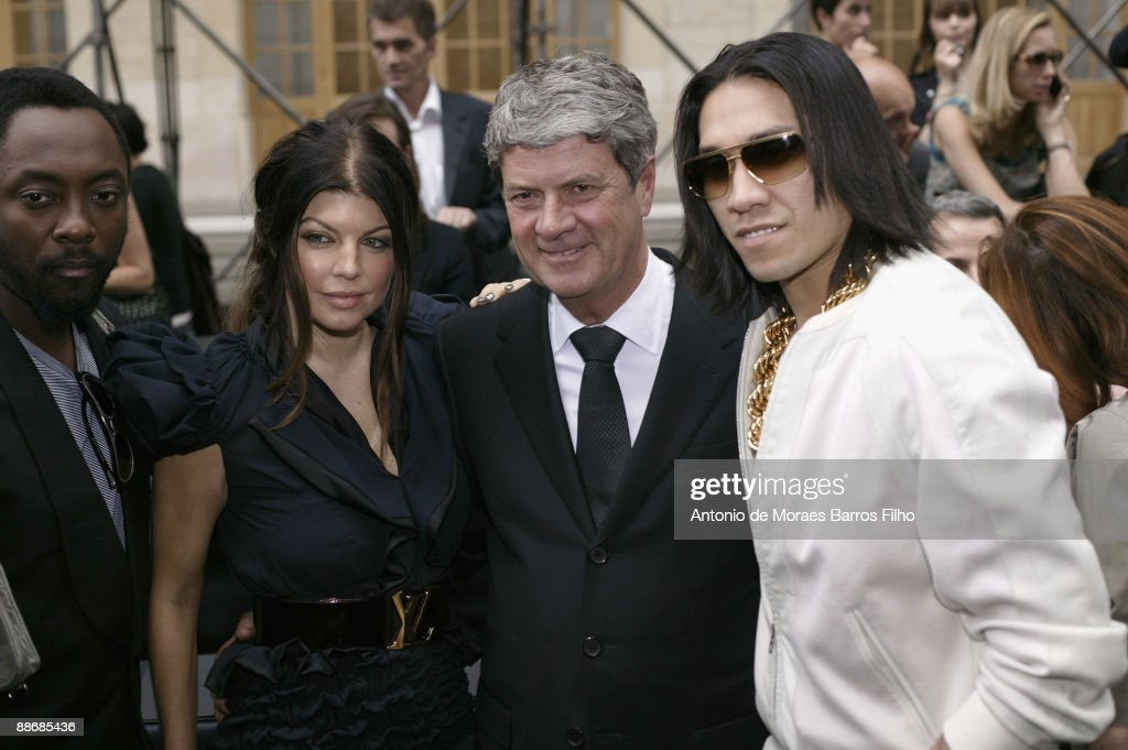 WillIAm Fergie and Taboo of the Black Eyed Peas and CEO of Louis Vuitton Yves Carcelle attend the Louis Vuitton show as part of Paris Menswear...