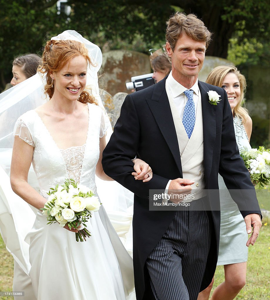 William Fox-Pitt escorts his sister Alicia Fox-Pitt to The Church of the Holy Cross for her wedding to Sebastian Stoddart in Goodnestone on July 20, 2013 near Dover, England.