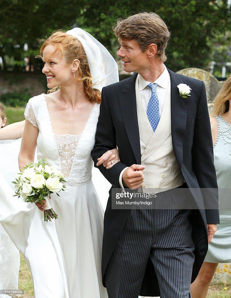 William Fox-Pitt escorts his sister Alicia Fox-Pitt to The Church of the Holy Cross for her wedding to Sebastian Stoddart in Goodnestone on July 20, 2013 near Dover, England.