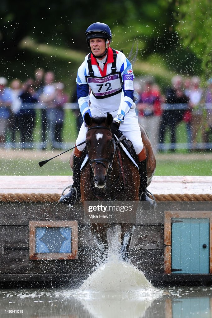 William FoxPitt of Great Britain riding Lionheart negotiates a water jump in the Eventing Cross Country Equestrian event on Day 3 of the London 2012...