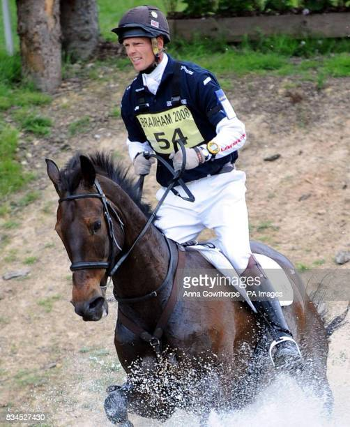 William FoxPitt riding Kaleidoscope goes through the water during the cross country course at Bramham International Horse Trials Bramham Leeds