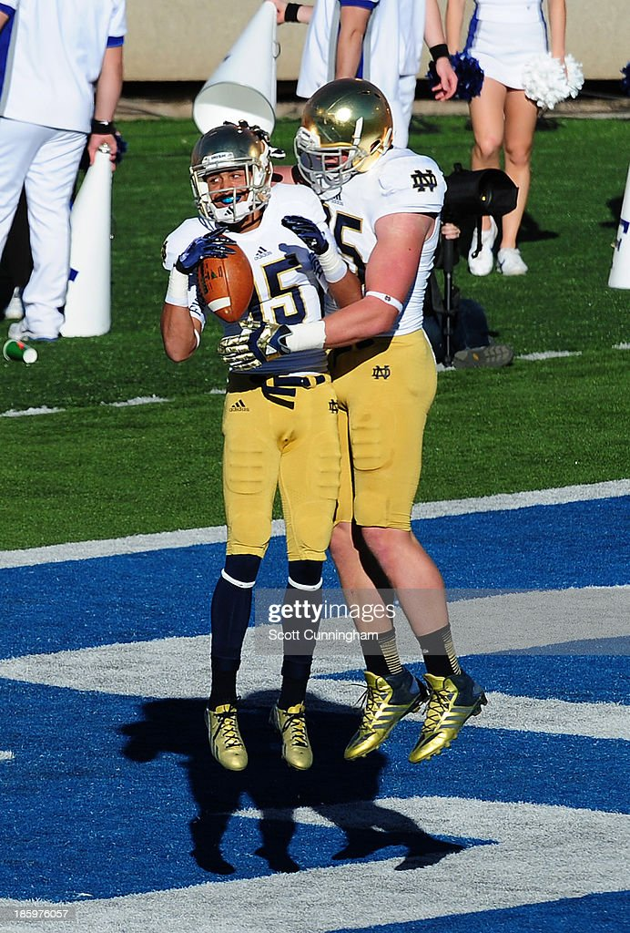 William Fuller #15 of the Notre Dame Fighting Irish celebrates with Troy Niklas #85 after scoring a touchdown against the Air Force Falcons at Falcon Stadium on October 26, 2013 in Colorado Springs, Colorado.