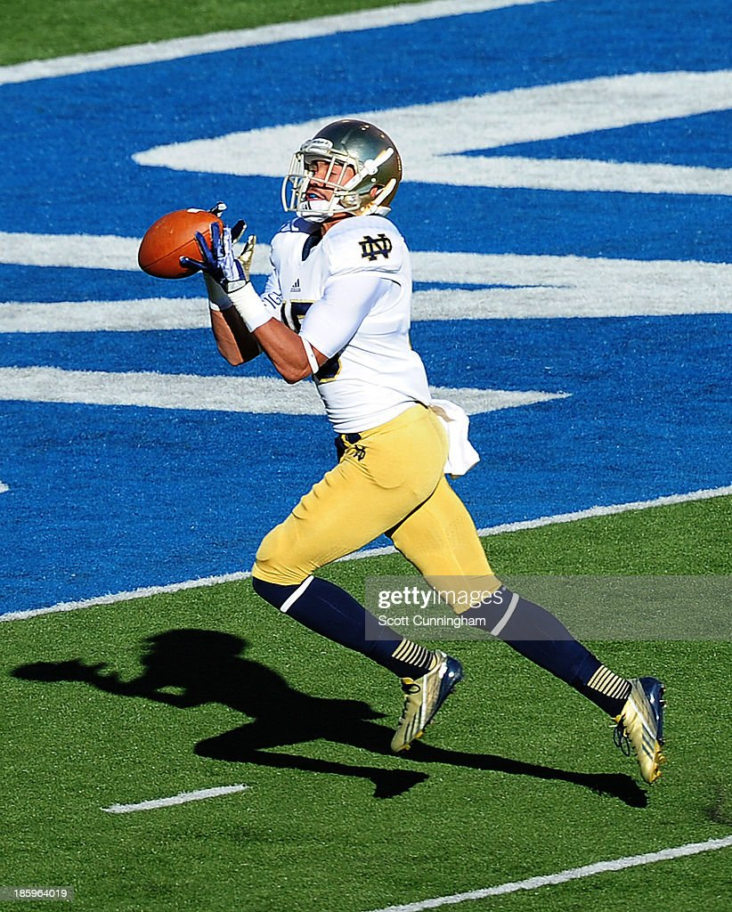 William Fuller #15 of the Notre Dame Fighting Irish makes a catch for a touchdown against the Air Force Falcons at Falcon Stadium on October 26, 2013 in Colorado Springs, Colorado.