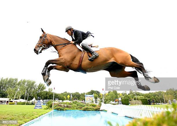 William Funnell of Great Britain ridding Cortaflex Mondriaan going over the water jump during the Longines King George V Gold Cup at the Longines...