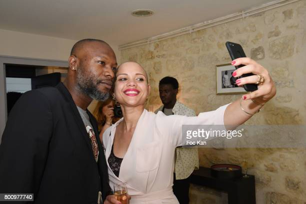 William Gallas and Karen Yassine pose for a selfie during the French Deal Cocktail as part of Paris Fashion Week on June 25 2017 in Paris France