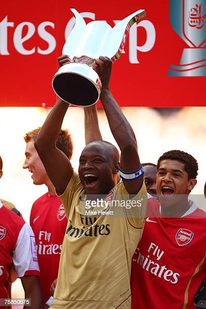 William Gallas of Arsenal lifts the Emirates trophy after the 'Emirates Cup' match between Arsenal and Inter Milan at the Emirates Stadium on July 29...