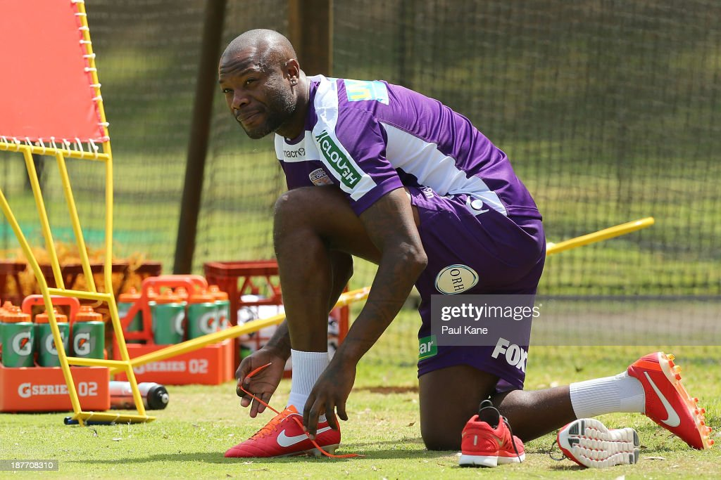 William Gallas of the Glory pulls the boots on for his first training session with the club during a Perth Glory A-League training session at McGillivray Oval on November 12, 2013 in Perth, Australia.