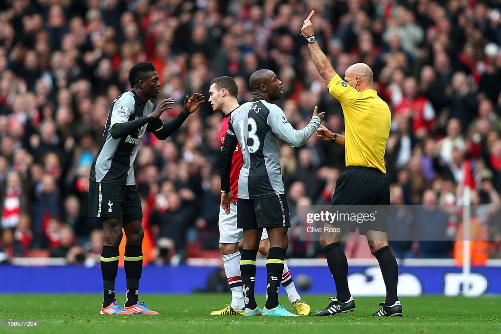 William Gallas protests to referee Howard Webb as team-mate Emmanuel Adebayor of Tottenham Hotspur (L) is shown a red card during the Barclays Premier league match between Arsenal and Tottenham Hotspur at Emirates Stadium on November 17, 2012 in London, England.