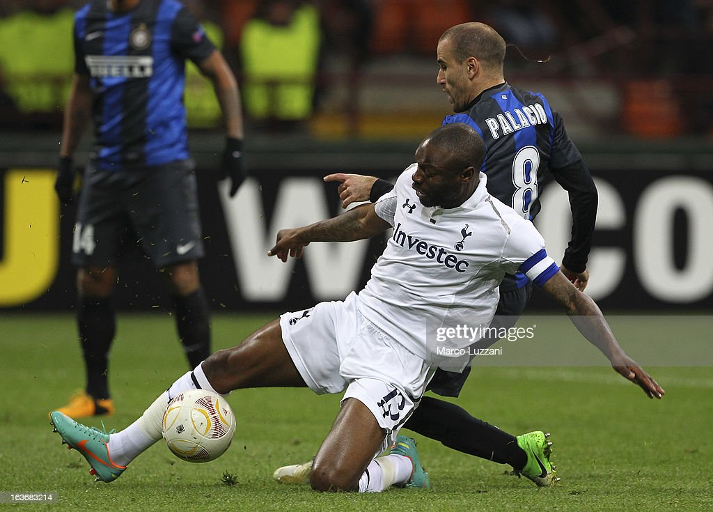 William Gallasof Tottenham Hotspur competes for the ball with Rodrigo Palacio of FC Internazionale Milano during the UEFA Europa League Round of 16 Second Leg match between FC Internazionale Milano and Tottenham Hotspur at San Siro Stadium on March 14, 2013 in Milan, Italy.