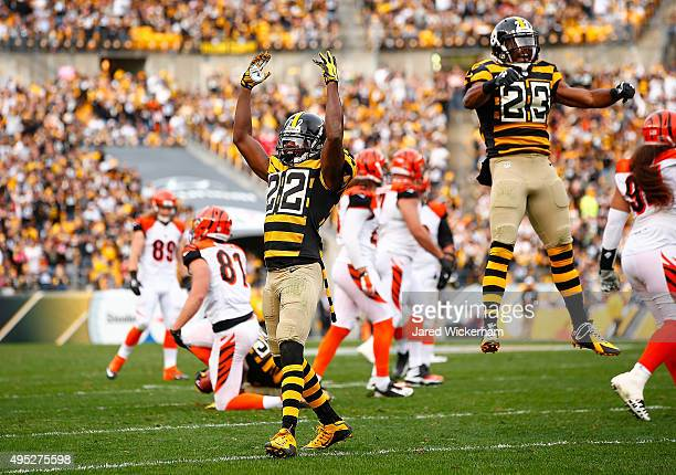 William Gay and Mike Mitchell of the Pittsburgh Steelers react after the Steelers blocked a field goal in the 3rd quarter of the game against the...
