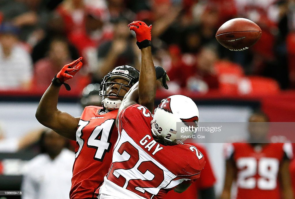 William Gay #22 of the Arizona Cardinals breaks up a reception intended for <a gi-track='captionPersonalityLinkClicked' href=/galleries/search?phrase=Roddy+White&family=editorial&specificpeople=750386 ng-click='$event.stopPropagation()'>Roddy White</a> #84 of the Atlanta Falcons that resulted in an interception at Georgia Dome on November 18, 2012 in Atlanta, Georgia.