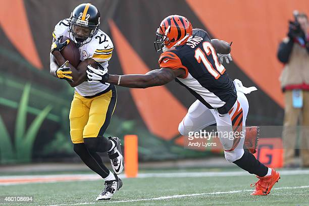 William Gay of the Pittsburgh Steelers breaks a tackle by Mohamed Sanu of the Cincinnati Bengals after intercepting a pass intended for Brandon Tate...
